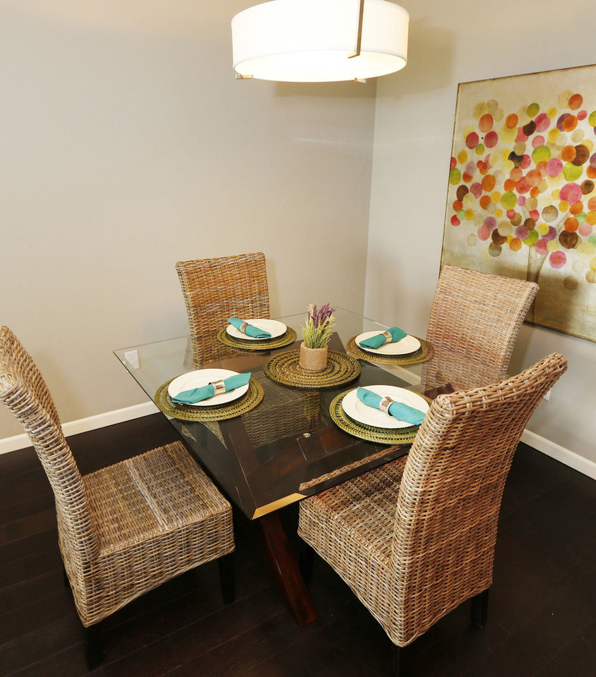 Photo - Dining area of a Johnston Builders  townhome in The Village.  Steve Gooch - The Oklahoman