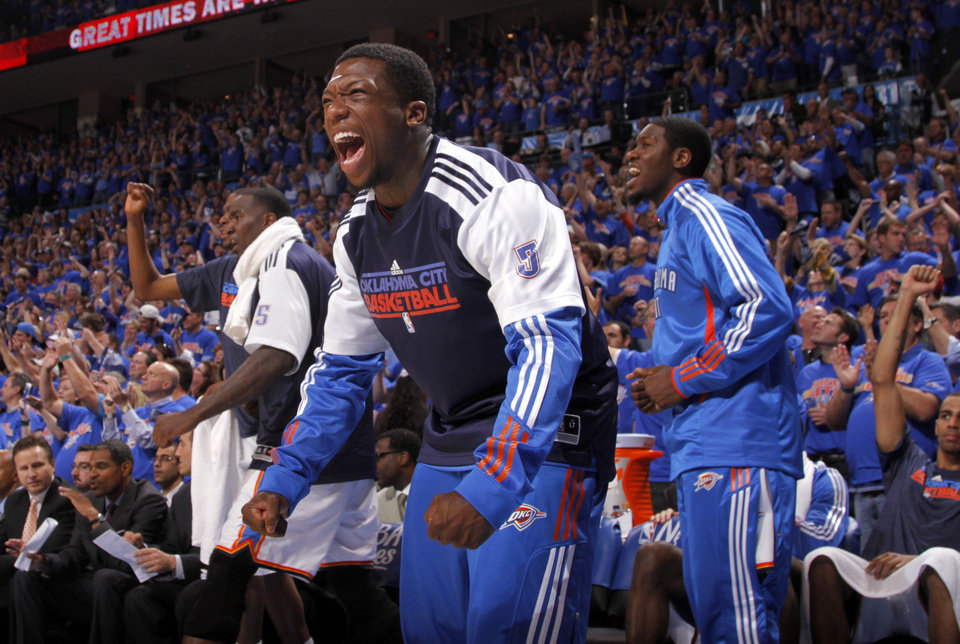 Photo - OKLAHOMA CITY ARENA / PLAYOFFS / CELEBRATION: Oklahoma City's Nate Robinson (3) celebrates during game 7 of the NBA basketball Western Conference semifinals between the Memphis Grizzlies and the Oklahoma City Thunder at the OKC Arena in Oklahoma City, Sunday, May 15, 2011. Photo by Sarah Phipps, The Oklahoman ORG XMIT: KOD