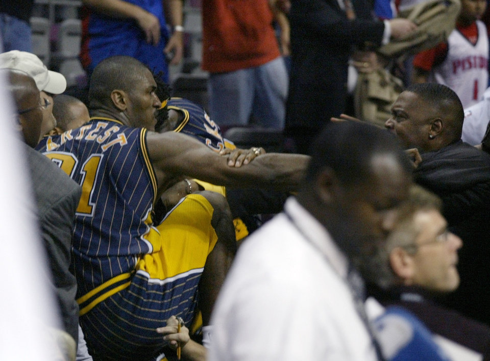 Photo -   FILE - This Nov. 19, 2004 file photo shows Indiana Pacers forward Ron Artest fighting with a fan during a a brawl at a game against the Detroit Pistons, in Auburn Hills, Mich. Violence is part of the game in many sports. But when athletes cross the line it can attract the attention of authorities _ sometimes from within their sport and in other cases from criminal prosecutors. The punishment of four members of the New Orleans Saints for participating a cash-for-hits bounty system targeting opponents is the latest example but not the only one. (AP Photo/Duane Burleson, File)