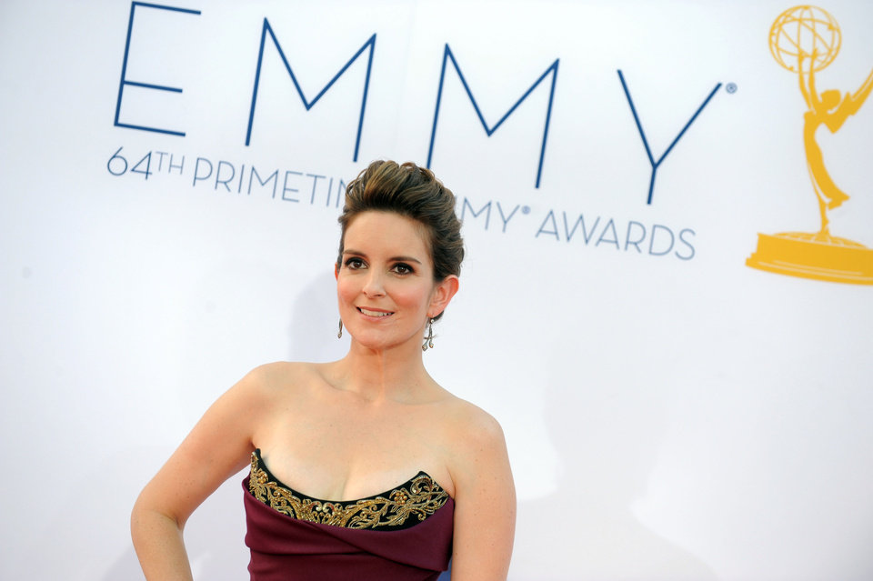 Photo -   Actress Tina Fey arrives at the 64th Primetime Emmy Awards at the Nokia Theatre on Sunday, Sept. 23, 2012, in Los Angeles. (Photo by Jordan Strauss/Invision/AP)