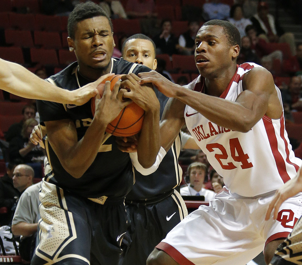 Photo - Oklahoma's Buddy Hield fights for the ball Idaho's Sekou Wiggs during a college basketball game between the University of Oklahoma Sooners and the Idaho Vandals at Lloyd Noble Center in Norman, Okla., on Wednesday, Nov. 13, 2013. Wednesday, Nov. 13, 2013. Photo by Bryan Terry, The Oklahoman