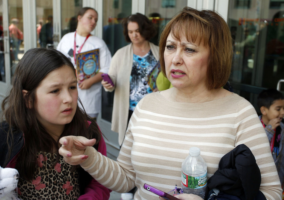 Photo - Rosa Viveiros, right, from Seekonk, Mass., along with her niece Lily Lannon, 9, left, describe the accident that happened during the Ringling Bros. and Barnum & Bailey Circus performance, Sunday, May 4, 2014, in Providence, R.I.  A platform collapsed during an aerial hair-hanging stunt at the 11 a.m. performance Sunday, sending eight acrobats plummeting to the ground. At least nine performers were seriously injured in the fall, including a dancer below, while an unknown number of others suffered minor injuries. (AP Photo/Stew Milne)