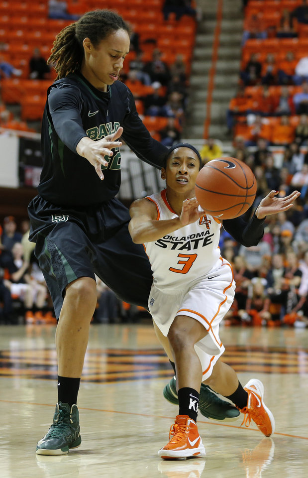 Oklahoma State's Tiffany Bias (3) passes  the ball beside Baylor's Brittney Griner (42) during a women's college basketball game between Oklahoma State University and Baylor at Gallagher-Iba Arena in Stillwater, Okla., Saturday, Feb. 2, 2013. Photo by Bryan Terry, The Oklahoman