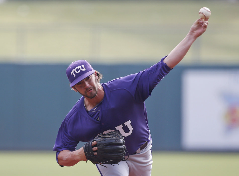 Photo - TCU's Brandon Finnegan pitches in the first inning of a game against Baylor in the Big 12 conference NCAA college baseball tournament in Oklahoma City, Saturday, May 24, 2014. (AP Photo/Sue Ogrocki)