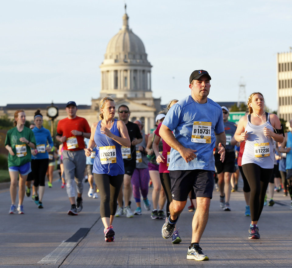 Photo - Runners travel north on Lincoln Blvd. past the state Capitol during the Oklahoma City Memorial Marathon in Oklahoma City, Sunday, April 24, 2016. Photo by Nate Billings, The Oklahoman