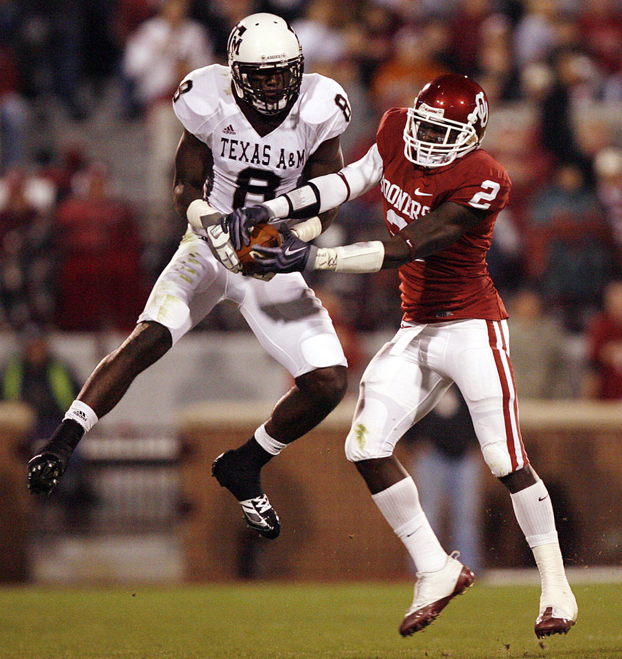 Photo - Oklahoma's Brian Jackson (2) defends on Texas A&M's Jeff Fuller (8) during the first half of the college football game between the University of Oklahoma Sooners (OU) and the Texas A&M Aggies at Gaylord Family-Memorial Stadium on Saturday, Nov. 14, 2009, in Norman, Okla. 