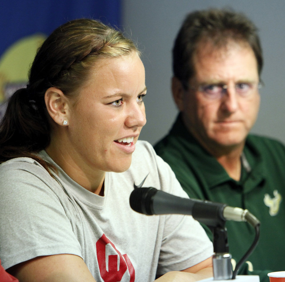 Oklahoma�s Keilani Ricketts, left, speaks as South Florida coach Ken Eriksen looks on Wednesday. Eriksen compared Ricketts to Babe Ruth because of her pitching and hitting dominance. Photo by Nate Billings, The Oklahoman