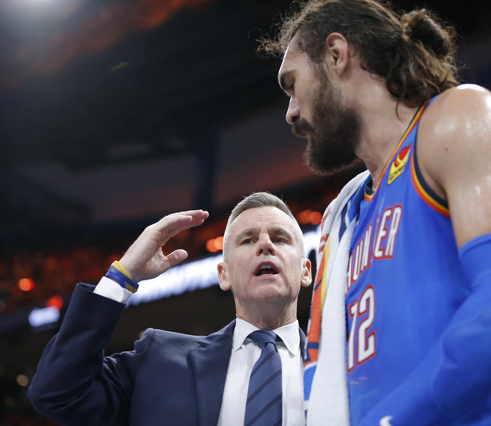 Photo - Oklahoma City coach Billy Donovan talks with Oklahoma City's Steven Adams (12) an NBA basketball game between the Oklahoma City Thunder and the Philadelphia 76ers at Chesapeake Arena in Oklahoma City, Friday, Nov. 15, 2019. Oklahoma City won 127-119. [Bryan Terry/The Oklahoman]