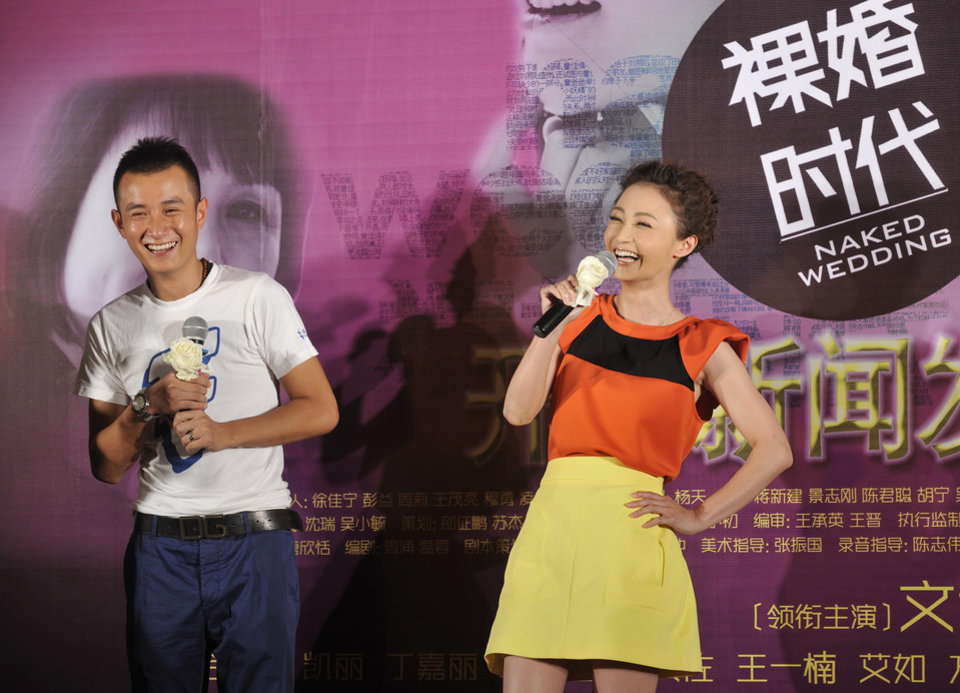 Photo - In this Thursday, June 9, 2011 photo, actor Wen Zhang, left, and actress Yao Di attend a presser for their new TV series