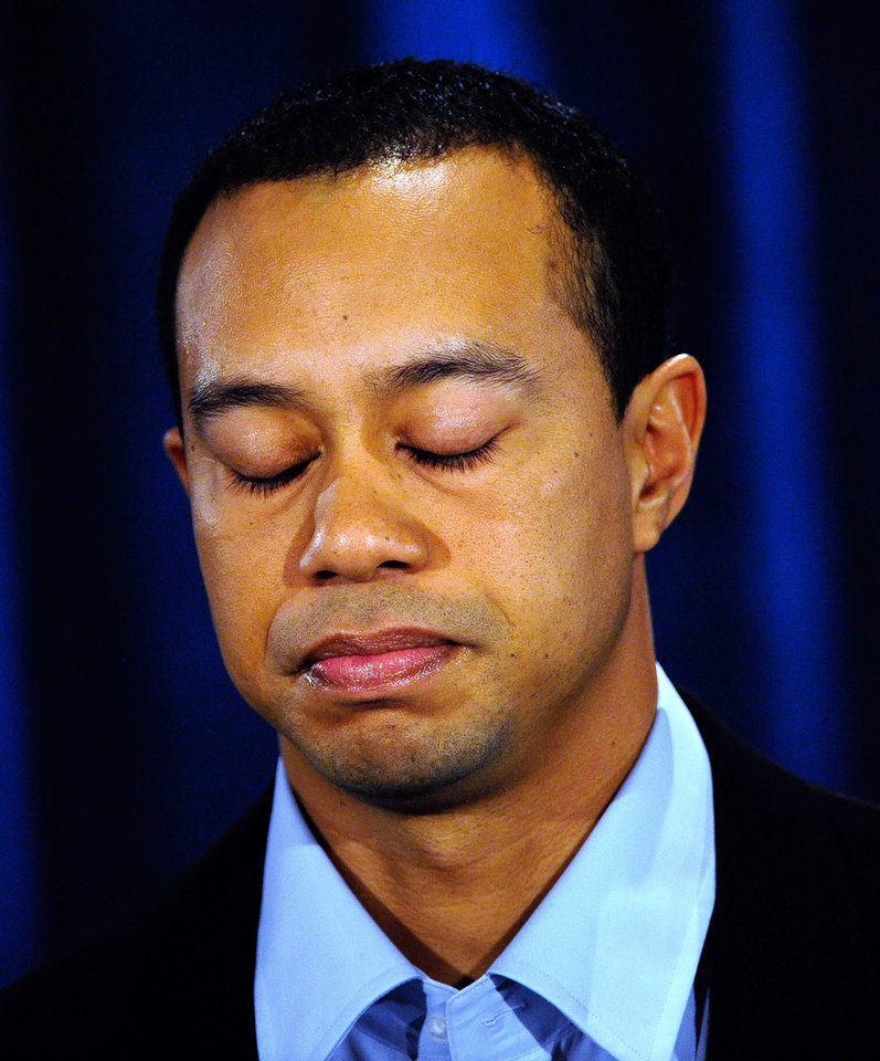 Photo - Tiger Woods makes a statement at the Sawgrass Players Club, Friday, Feb. 19, 2010, in Ponte Vedra Beach, Fla. (AP Photo/Sam Greenwood, Pool) ORG XMIT: TWP118