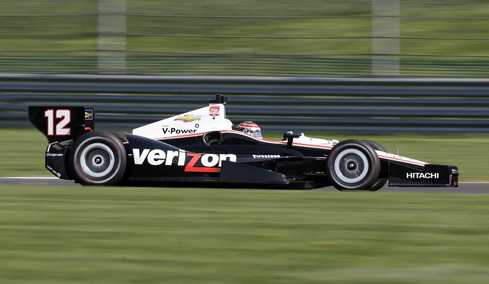 Photo - Will Power, of Australia, speeds through a turn during practice for the inaugural Grand Prix of Indianapolis IndyCar auto race at the Indianapolis Motor Speedway in Indianapolis, Thursday, May 8, 2014. (AP Photo/Michael Conroy)