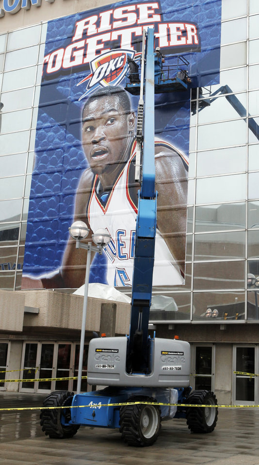 Photo - NBA BASKETBALL PLAYOFFS: Workers assemble giant photographs of Oklahoma City Thunder players, including Kevin Durant shown here, on the south side of the Cox Convention Center for the NBA playoffs, in Oklahoma City, Friday, April 16, 2010. Photo by Nate Billings, The Oklahoman ORG XMIT: KOD
