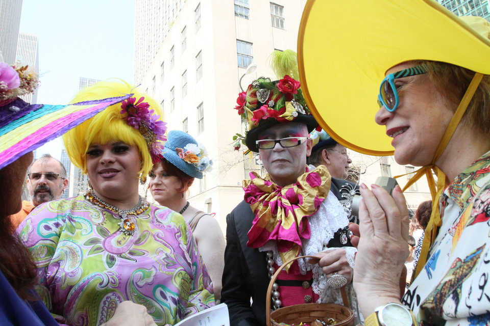 Photo -   Mariette Pathy Allen, right, and others talk with other participants in the Easter Day parade along New York's Fifth Avenue on Sunday, April 24, 2011. (AP Photo/Tina Fineberg)