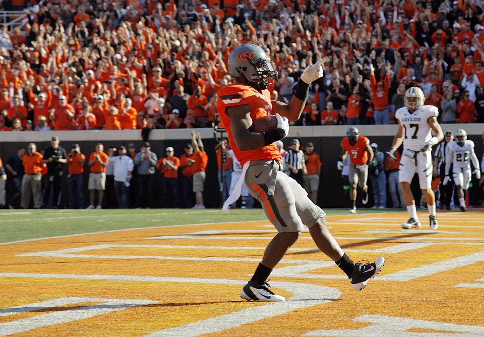 Photo - OSU's Joseph Randle (1) reacts after scoring a touchdown in the second quarter during a college football game between the Oklahoma State University Cowboys (OSU) and the Baylor University Bears (BU) at Boone Pickens Stadium in Stillwater, Okla., Saturday, Oct. 29, 2011. Photo by Nate Billings, The Oklahoman