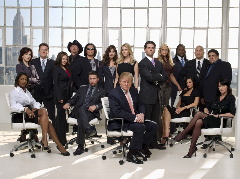 This photo released by NBC shows the cast for Celebrity Apprentice. Pictured: (back row l-r) Merilu Henner, Piers Morgan, Nelly Galan, Trace Adkins, Gene Simmons, Carol Alt, Ivanka Trump, Donald Trump, Jr., Jennie Finch, Lennox Lewis, Tito Ortiz, Vinnie Pastore, (bottom row l-r) Omorosa, Stephen Baldwin, Donald Trump, Tiffany Fallon, Nadia Comeneci. (AP Photo/ NBC, Justin Stephens)
