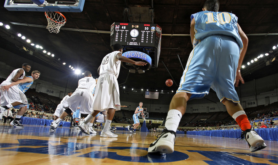 Oktaha's Blake Pittman (10) passes the ball inbounds during the first round 2A boy's State Basketball Championship game between Northeast High School and Oktaha High School at the State Fair Arena on Thursday, March 8, 2012 in Oklahoma City, Okla.  Photo by Chris Landsberger, The Oklahoman