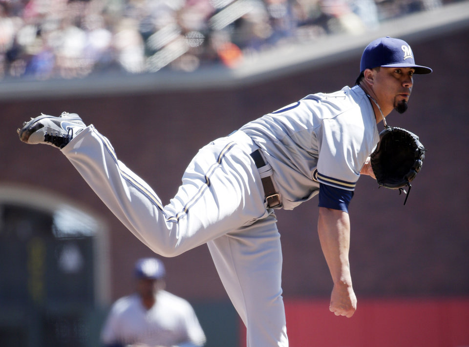 Photo - Milwaukee Brewers starting pitcher Kyle Lohse throws to the San Francisco Giants during the first inning of a baseball game on Sunday, Aug. 31, 2014, in San Francisco. (AP Photo/Marcio Jose Sanchez)