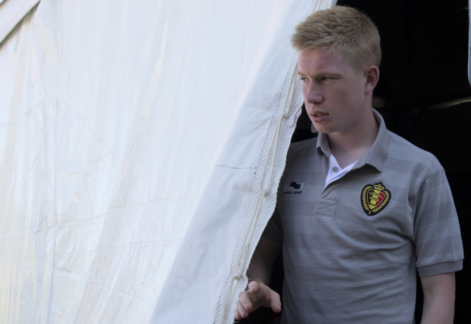 Photo - Belgium midfielder Kevin De Bruyne leaves at the end of a press conference at the team's training facility, in Mogi Das Cruzes, Brazil, Thursday, June 12, 2014. Belgium plays in the group H of the 2014 soccer World Cup. (AP Photo/Andrew Medichini)