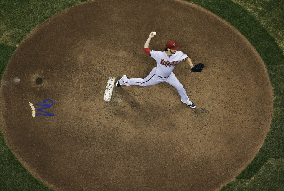 Photo - Arizona Diamondbacks starting pitcher Mike Bolsinger throws during the first inning of a baseball game against the Milwaukee Brewers Monday, May 5, 2014, in Milwaukee. (AP Photo/Morry Gash)