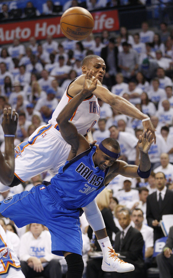 Photo -   Oklahoma City Thunder guard Russell Westbrook, rear, fouls Dallas Mavericks guard Jason Terry (31) as Terry shoots in the fourth quarter of Game 2 in the first round of the NBA basketball playoffs, in Oklahoma City, Monday, April 30, 2012. Oklahoma City won 102-99. (AP Photo/Sue Ogrocki)