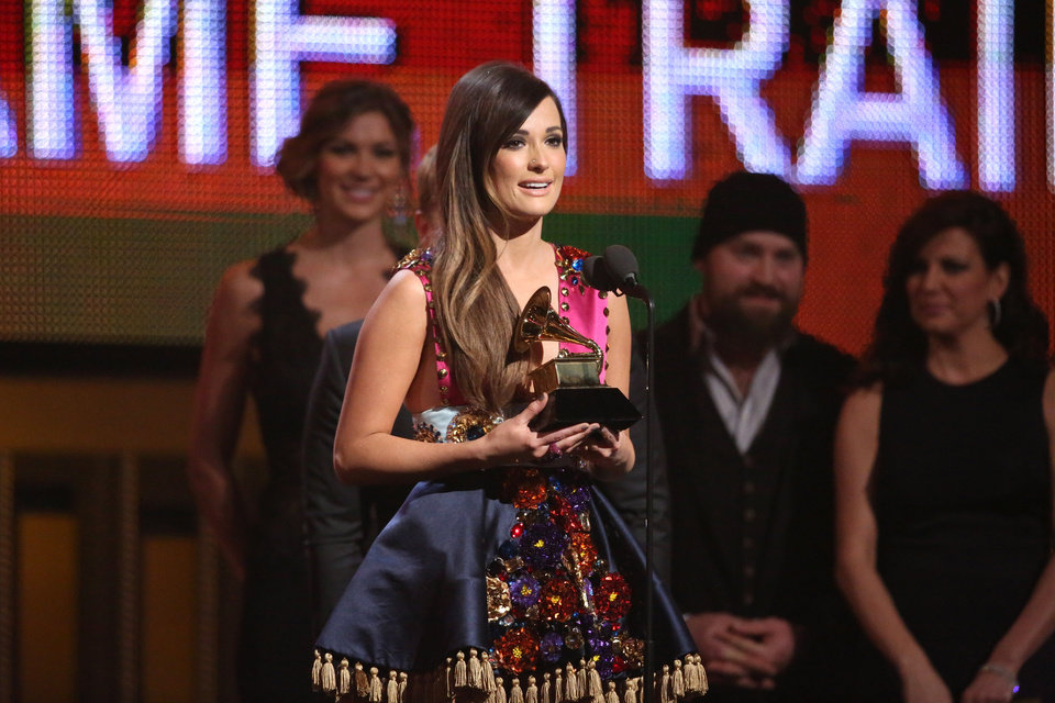 Photo - Kacey Musgraves accepts the award for best country album at the 56th annual GRAMMY Awards at Staples Center on Sunday, Jan. 26, 2014, in Los Angeles. (Photo by Matt Sayles/Invision/AP)