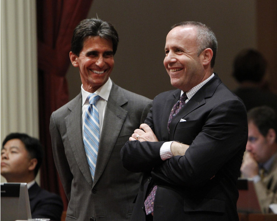 Photo -   Senate Mark Leno, D-San Francisco, left, and Senate President Pro Tem Darrell Steinberg, right, smile as the vote is taken for a bill authorizing about $4.5 billion in funding for a high-speed rail system, at the Capitol in Sacramento, Calif., Friday, July 6, 2012. The bill, which would allow the state to begin selling $2.6 billion in voter -approved bonds, was approved by a 21-16 vote and now goes to Gov. Jerry Brown who has supports the measure.(AP Photo/Rich Pedroncelli)