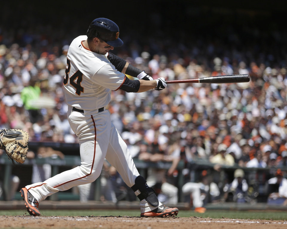 Photo - San Francisco Giants' Andrew Susac swings for an RBI single off Pittsburgh Pirates' Charlie Morton in the third inning of a baseball game Wednesday, July 30, 2014, in San Francisco. (AP Photo/Ben Margot)