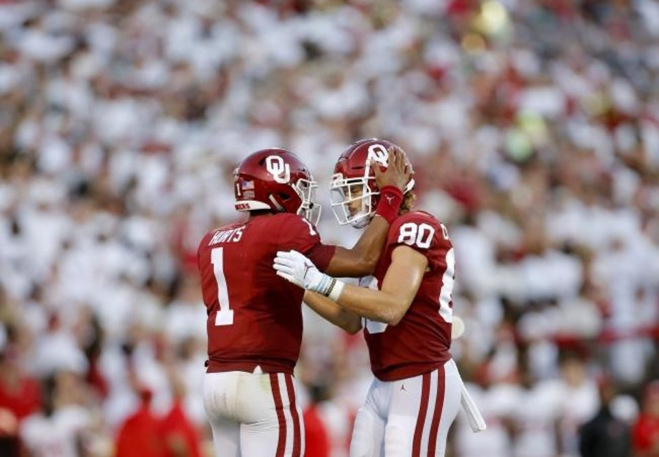 Photo -  Oklahoma's Jalen Hurts (1) and Grant Calcaterra (80) celebrate a play in the season-opening win against Houston on Sept. 1 in Norman. [Sarah Phipps/The Oklahoman]