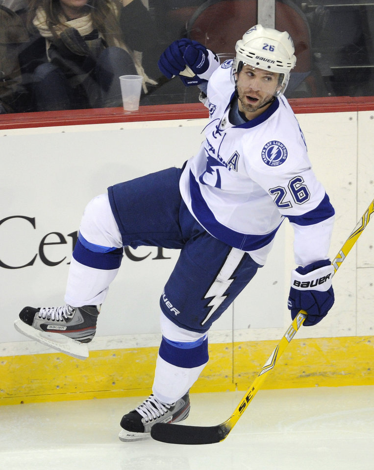 Tampa Bay Lightning's Martin St. Louis celebrates his goal during the second period of an NHL hockey game against the New Jersey Devils Tuesday, March 5, 2013, in Newark, N.J. (AP Photo/Bill Kostroun)