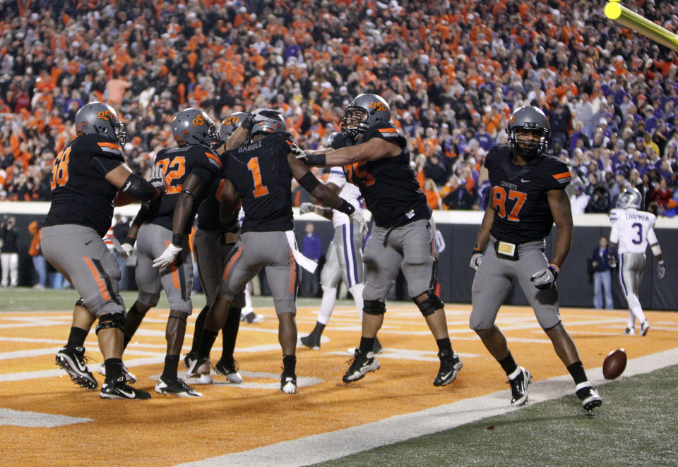 Photo - Oklahoma State celebrates Oklahoma State's Joseph Randle (1) game-winning touchdown during a college football game between the Oklahoma State University Cowboys (OSU) and the Kansas State University Wildcats (KSU) at Boone Pickens Stadium in Stillwater, Okla., Saturday, Nov. 5, 2011.  Photo by Sarah Phipps, The Oklahoman
