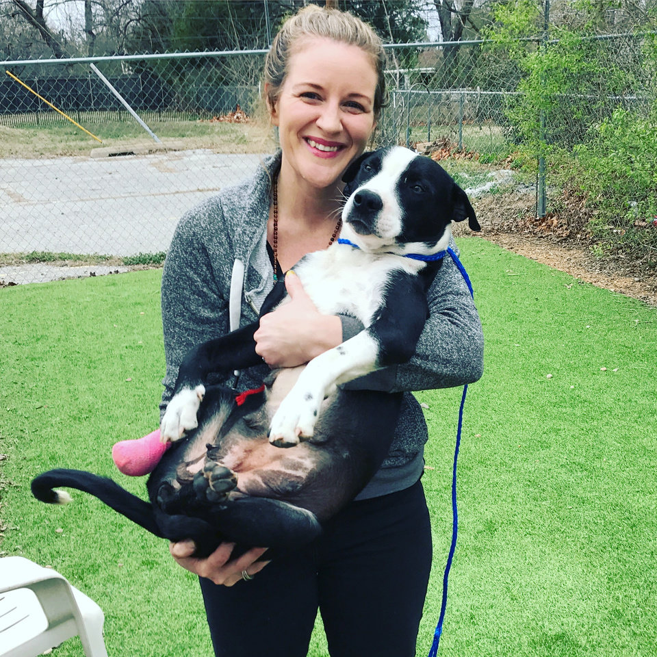 Photo -  Rebecca Bean, the owner of Stash, holds Hope, a rescue dog who came to her from a rural area outside of Tahlequah. Her leg was so badly infected, it had to be amputated. But Hope fully recovered and now lives with a wonderful family in Norman, Bean says. [Photo provided]