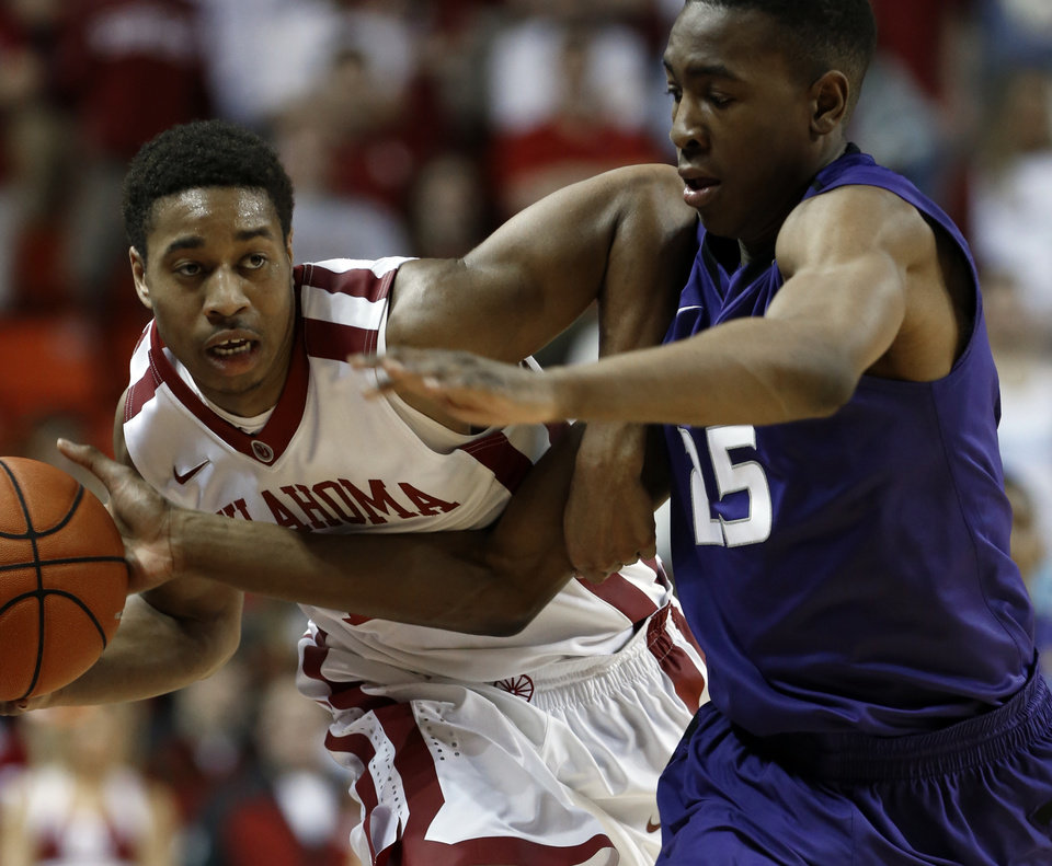 Photo - Oklahoma Sooner's Isaiah Cousins is fouled bringing the ball up the court by Kansas State Wildcat's Wesley Iwundu (25) as the University of Oklahoma Sooner (OU) men play the Kansas State Wildcats (KS) in NCAA, college basketball at The Lloyd Noble Center on Saturday, Feb. 22, 2014 in Norman, Okla. Photo by Steve Sisney, The Oklahoman