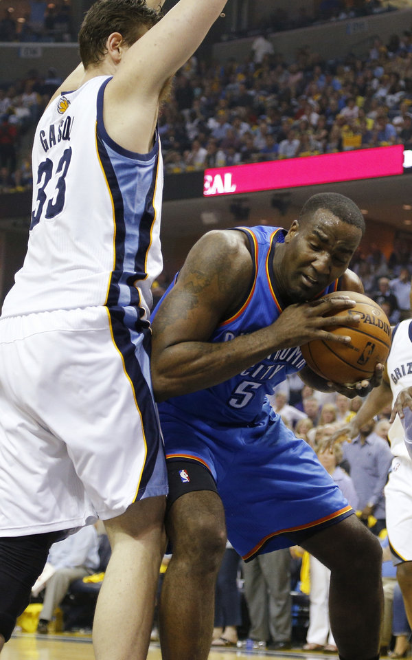 Photo - Oklahoma City's Kendrick Perkins (5) works against Memphis' Marc Gasol (33) during Game 4 in the first round of the NBA playoffs between the Oklahoma City Thunder and the Memphis Grizzlies at FedExForum in Memphis, Tenn., Saturday, April 26, 2014. Photo by Bryan Terry, The Oklahoman