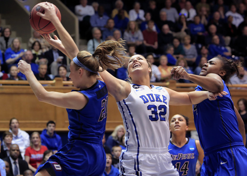 Photo - DePaul's Megan Rogowski, left, blocks a shot by Duke's Tricia Liston (32) near DePaul's Brandi Harvey-Carr, right, during the first half of their second-round game in the NCAA basketball tournament in Durham, N.C., Monday, March 24, 2014.  (AP Photo/Ted Richardson)