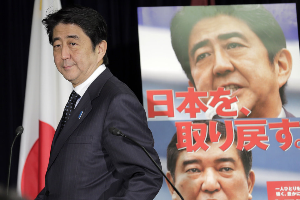 "Japan's largest opposition Liberal Democratic Party leader Shinzo Abe arrives for a press conference in Tokyo, Friday, Nov. 16, 2012 after the lower house of parliament was dissolved. Prime Minister Yoshihiko Noda dissolved the lower house of parliament Friday, paving the way for elections in which his ruling party will likely give way to a weak coalition government divided over how to solve Japan's myriad problems. Abe, who had a one-year stint as prime minister in 2006 and 2007, now has a chance to return if the LDP wins the most seats in the upcoming elections expected in mid December. Japanese on the poster reads: ""We get back Japan."" (AP Photo/Koji Sasahara) (AP Photo/Koji Sasahara)"