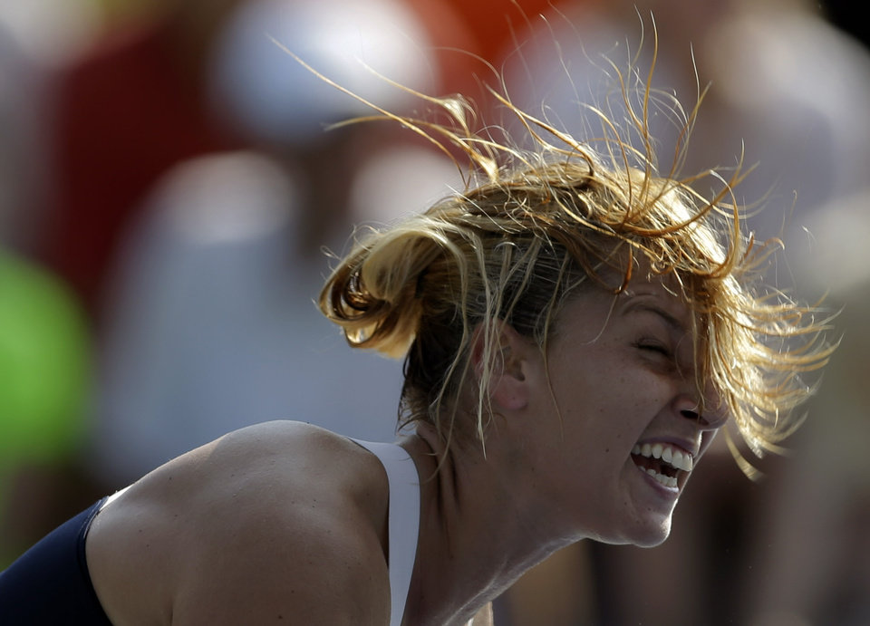 Photo - Dominika Cibulkova, of Slovakia, follows through on a serve against Catherine Bellis, of the United States, during the first round of the 2014 U.S. Open tennis tournament, Tuesday, Aug. 26, 2014, in New York. (AP Photo/Darron Cummings)