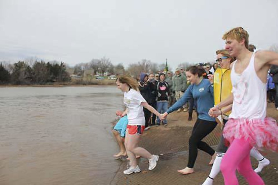 Volunteers head for the frigid water during the 2012 Polar Plunge at Stillwater's Boomer Lake. PHOTO PROVIDED