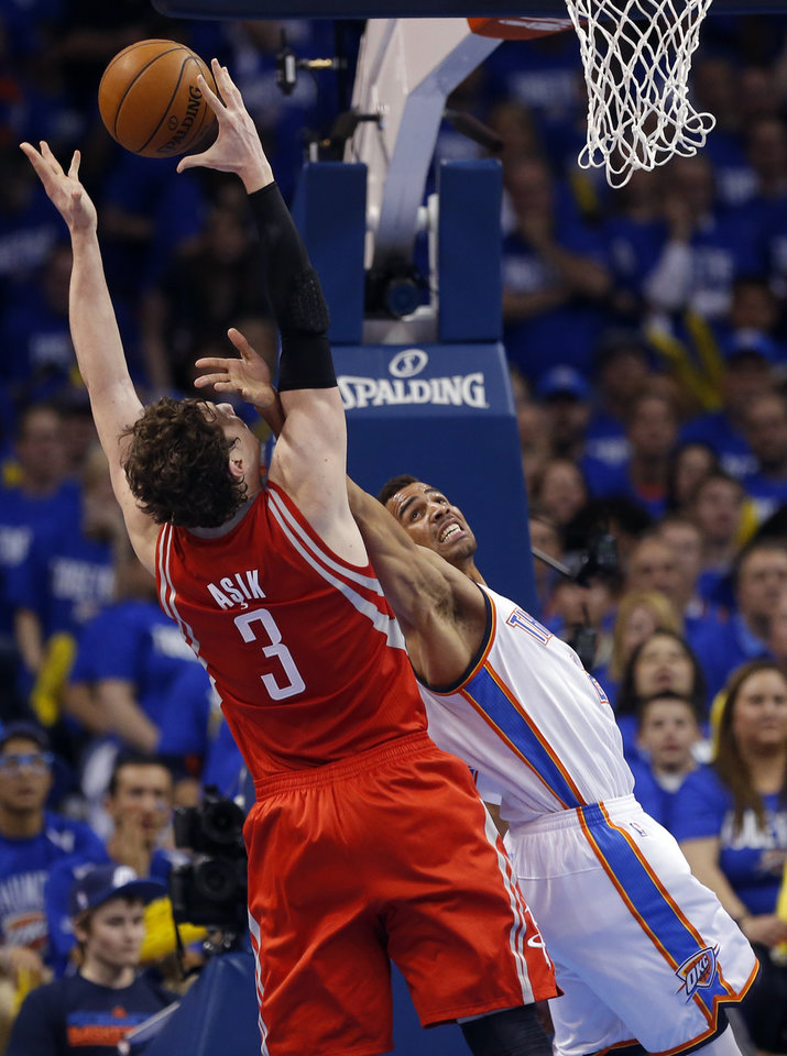 Photo - Oklahoma City's Thabo Sefolosha (2) defends against Houston's Omer Asik (3) during Game 1 in the first round of the NBA playoffs between the Oklahoma City Thunder and the Houston Rockets at Chesapeake Energy Arena in Oklahoma City, Sunday, April 21, 2013. Photo by Sarah Phipps, The Oklahoman