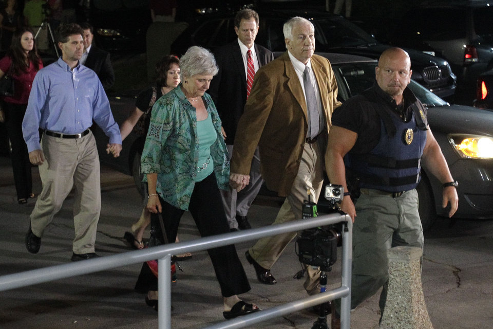 Photo -   Former Penn State University assistant football coach Jerry Sandusky, right center, arrives with his wife Dottie, left center, at the Centre County Courthouse in Bellefonte, Pa., Friday, June 22, 2012. Sandusky is accused of sexual abuse of 10 boys over a 15-year period. (AP Photo/Gene J. Puskar)