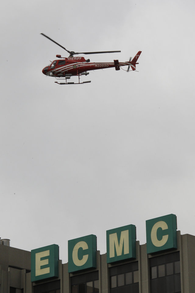 Photo -   An Erie County Sheriff's helicopter searches at the scene of a shooting at Erie Count Medical Center in Buffalo, N.Y., Wednesday, June 13, 2012. A police official confirms that a woman was killed Wednesday morning on the grounds of the Erie County Medical Center, which he describes as being in