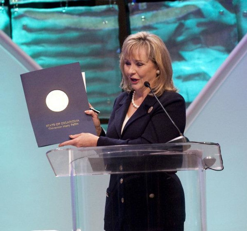 Photo - Gov. Mary Fallin discusses her energy plan Wednesday during the 2011 Governor's Energy Conference at the Cox Convention Center. Photo by Steve Maupin, For The Oklahoman