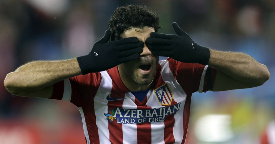 Photo - Atletico's Diego Costa celebrates scoring the opening goal during a Champions League, round of 16, second leg, soccer match between Atletico Madrid and AC Milan at the Vicente Calderon stadium in Madrid, Tuesday March 11, 2014. (AP Photo/Paul White)