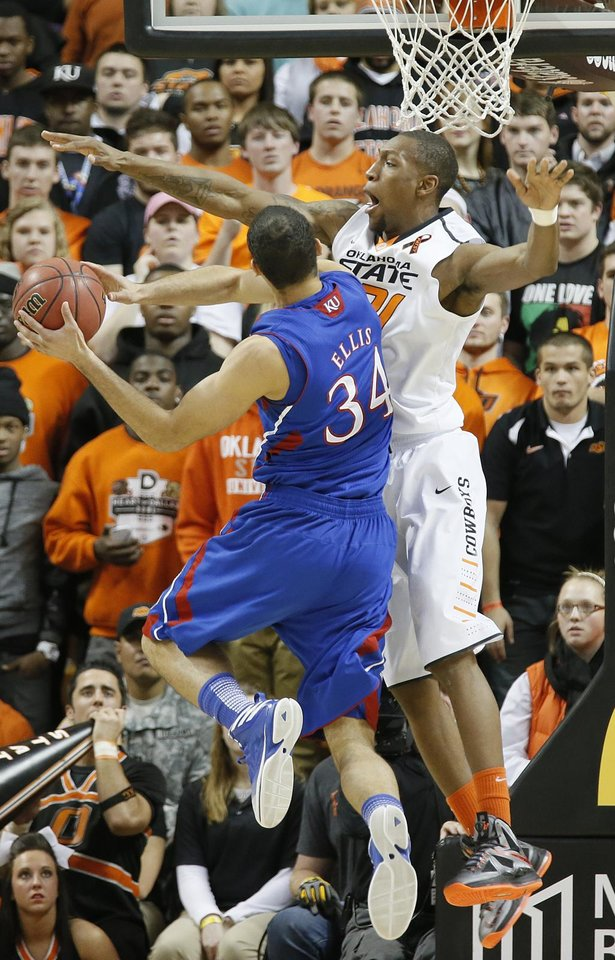 Photo - Oklahoma State 's Kamari Murphy (21) defends on Kansas' Perry Ellis (34) during the college basketball game between the Oklahoma State University Cowboys (OSU) and the University of Kanas Jayhawks (KU) at Gallagher-Iba Arena on Wednesday, Feb. 20, 2013, in Stillwater, Okla. Photo by Chris Landsberger, The Oklahoman