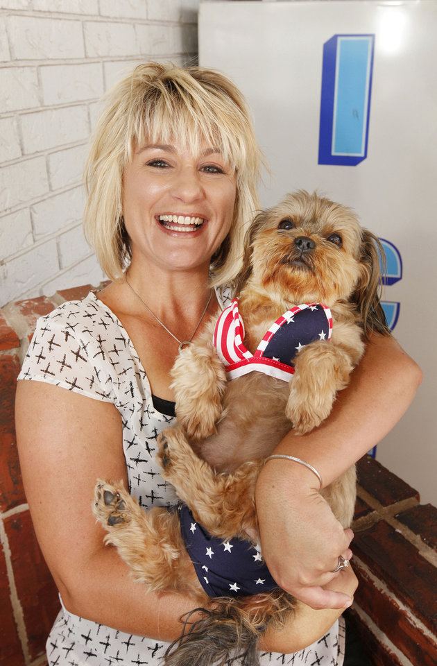 Photo - Sadie, part Shih Tzu and Yorkie, hangs out next to the ice machine in her bikini with owner Kelsie Dean at Paul's Conoco on May Ave. and Hefner Road.  Photo by Paul B. Southerland, The Oklahoman  PAUL B. SOUTHERLAND