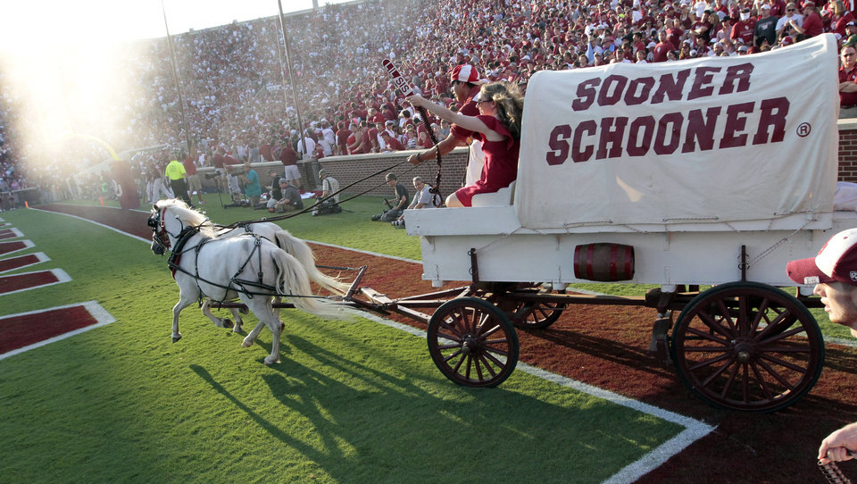 Photo - Ruff/Neks drive the Sooner Schooner after a touchdown during the first half of the college football game where the University of Oklahoma Sooners (OU) play the University of Louisiana Monroe Warhawks at Gaylord Family-Oklahoma Memorial Stadium in Norman, Okla., on Saturday, Aug. 31, 2013. Photo by Steve Sisney, The Oklahoman