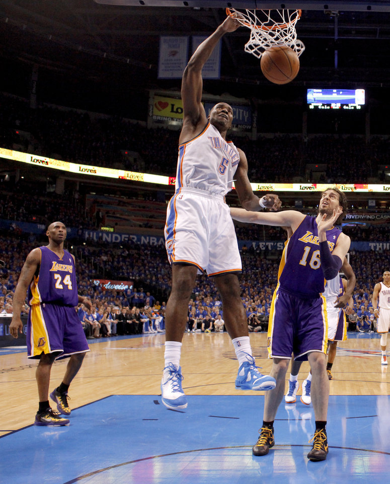Photo - Oklahoma City's Kendrick Perkins (5) dunks the ball between Los Angeles' Kobe Bryant (24), and Pau Gasol (16) during Game 5 in the second round of the NBA playoffs between the Oklahoma City Thunder and the L.A. Lakers at Chesapeake Energy Arena in Oklahoma City, Monday, May 21, 2012. Oklahoma City won 106-90.  Photo by Bryan Terry, The Oklahoman
