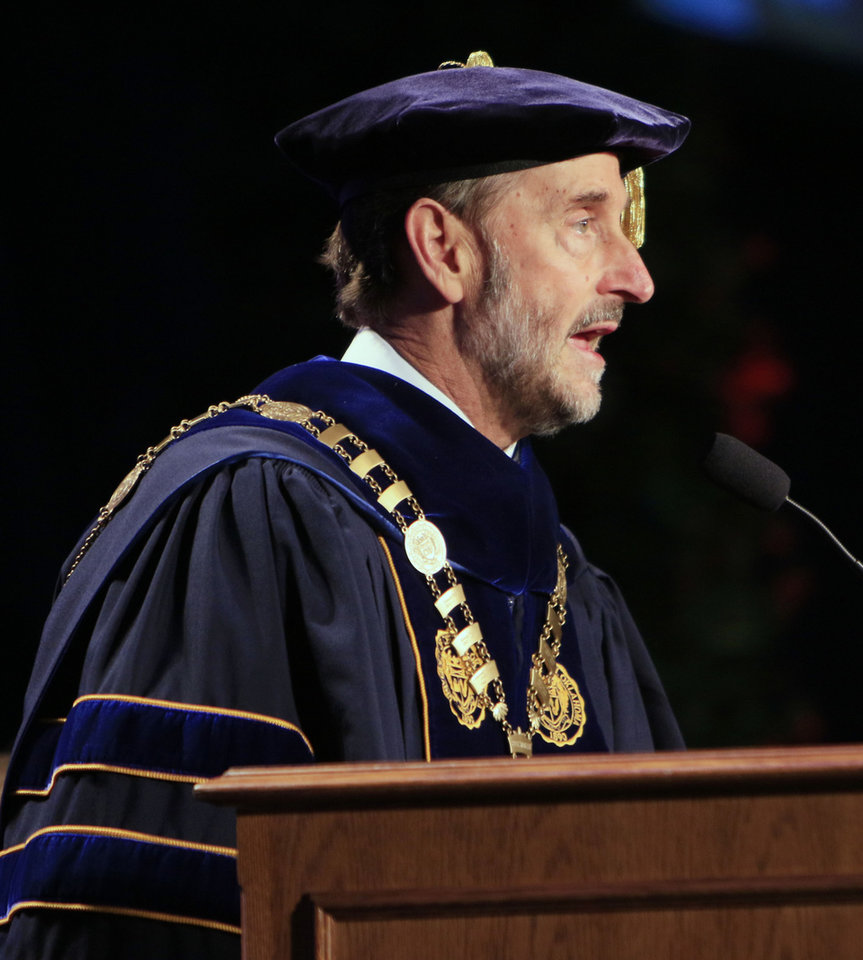 Photo -  University of Central Oklahoman President Don Betz speaks during the 2015 graduation ceremony. [PHOTO BY PAUL HELLSTERN, THE OKLAHOMAN ARCHIVES]