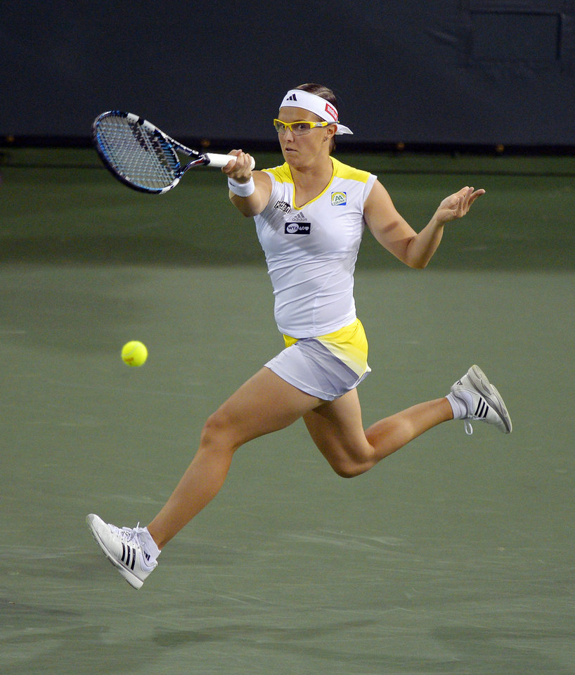 Photo - Kirsten Flipkens, of Belgium, returns a shot to Victoria Azarenka, of Belarus, during their match at the BNP Paribas Open tennis tournament, Monday, March 11, 2013, in Indian Wells, Calif. (AP Photo/Mark J. Terrill)