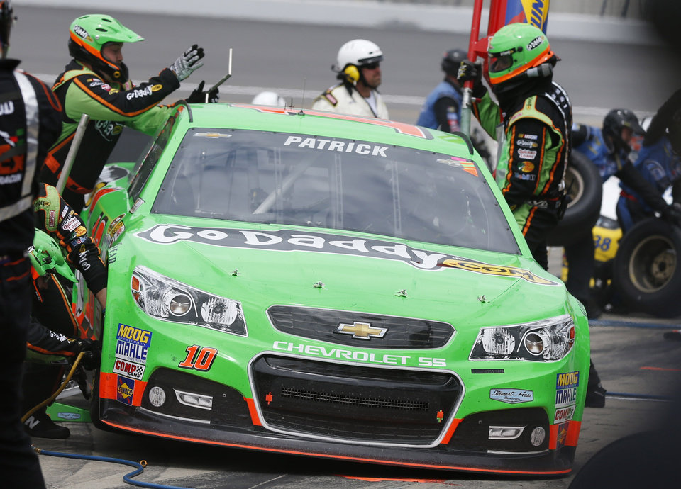 Danica Patrick (10) pits during a NASCAR Sprint Cup series auto race at Kansas Speedway in Kansas City, Kan., Sunday, April 21, 2013. (AP Photo/Orlin Wagner)