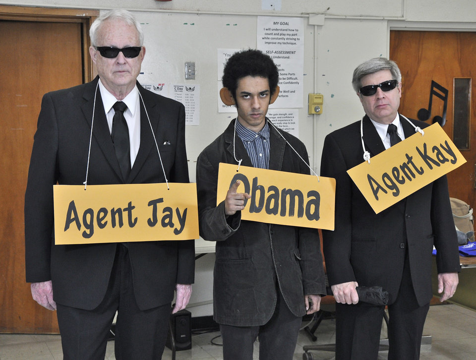 Photo -  From left, Bob Hale as Agent Jay, Alex Zabel as President Barack Obama, and David Fritze, as Agent Kay, at a rehearsal for the upcoming 2014 Oklahoma City Gridiron Show. Photo by M. Tim Blake, for The Oklahoman   M. Tim Blake